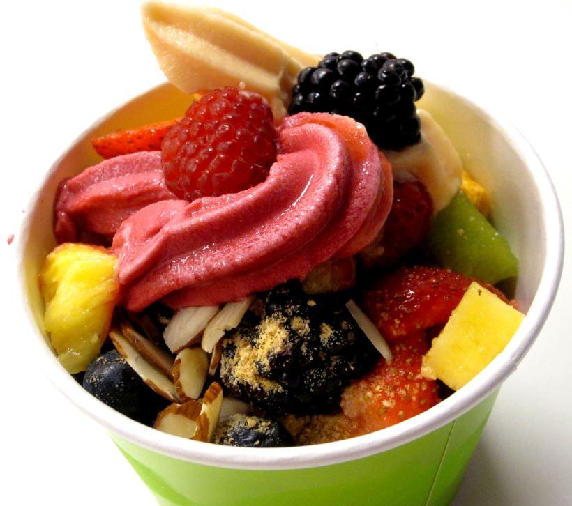 Mango and pomegranate raspberry frozen yogurt, topped with strawberries, raspberries, blackberries, blueberries, kiwi, almond slices and pineapple chunks.