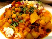 Curried potatoes and chickpeas served over almond jasmine rice with sweet apple cole slaw.