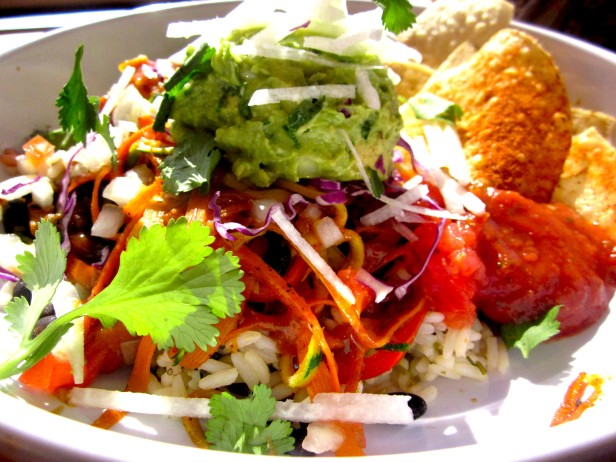 My go-to: a veggie burrito bowl without the dairy! This colorful bowl comes with cilantro rice, red bell pepper slices, carrot strips, shredded zucchini, purple cabbage, jicama, black beans, corn, and an addition I haven't seen elsewhere: slivers of mango. I particularly enjoy the combination of these fresh flavors smothered in guacamole, with a drizzle of lime juice and several dashes of black pepper.